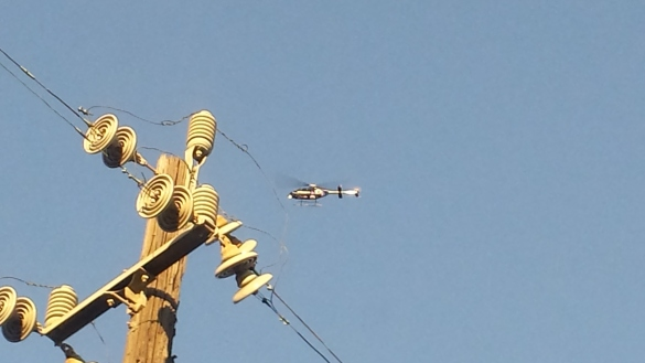 Electric chopper over East Oakland